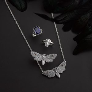 coffin ring & moth ring, blue octagon